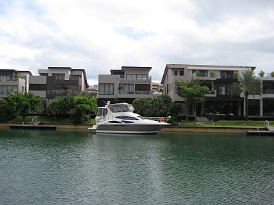 The view of some of the houses with a boat in the marina..